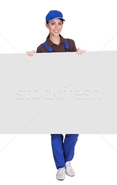 笑みを浮かべて 女性 配管 プラカード 孤立した ストックフォト © AndreyPopov