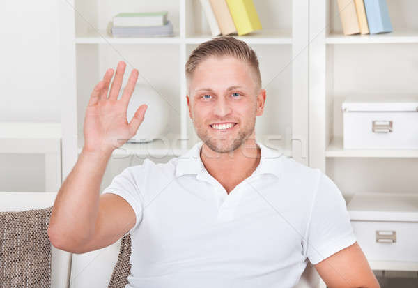 Businessman waving in pleasure to his laptop Stock photo © AndreyPopov