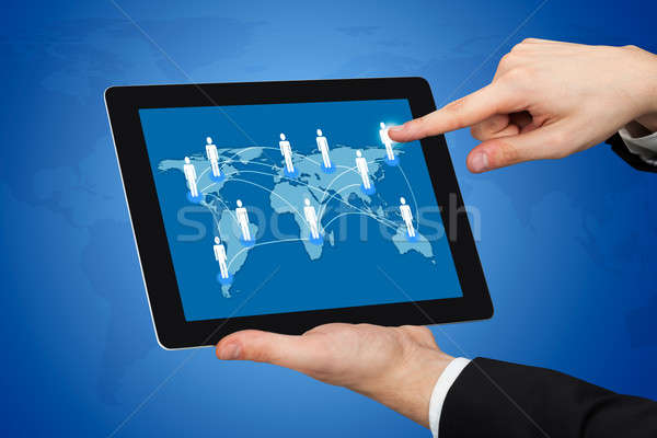 Businessman Touching World Map On Digital Tablet Stock photo © AndreyPopov