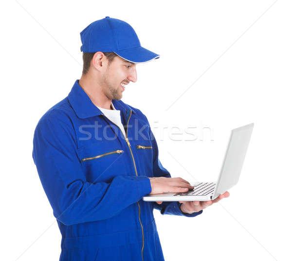 Mechanic Using Laptop Over White Background Stock photo © AndreyPopov