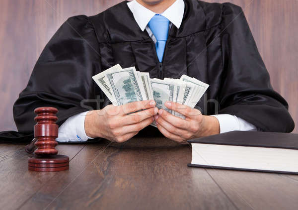 Judge Counting Money Stock photo © AndreyPopov