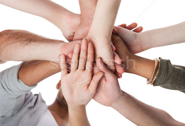 Young College Students Stacking Hands Stock photo © AndreyPopov