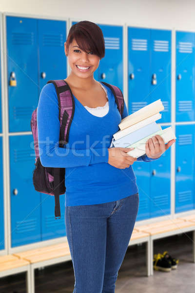 Portrait Of Female Student Holding Book Stock photo © AndreyPopov