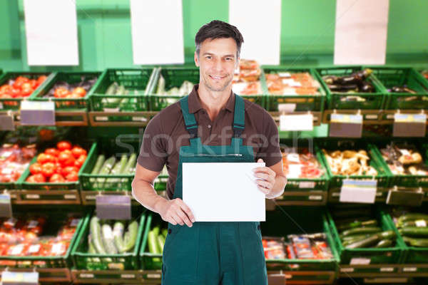 Férfi eladó tart plakát érett áruház Stock fotó © AndreyPopov