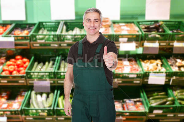 Male Sales Clerk Showing Thumb Up Gesture Stock photo © AndreyPopov