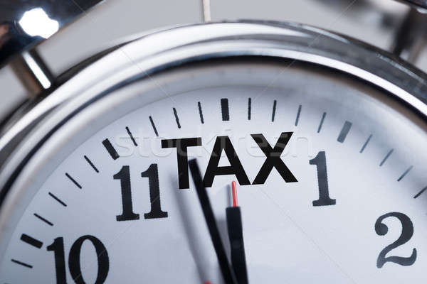 Alarmclock Showing Arrival Of Tax Time Stock photo © AndreyPopov