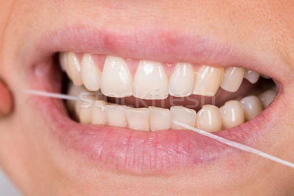 Woman Flossing Teeth Stock photo © AndreyPopov