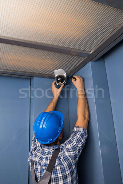 Technician Adjusting Security Camera Stock photo © AndreyPopov