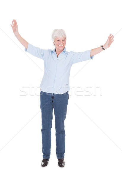 Senior Woman With Arms Outstretched Stock photo © AndreyPopov