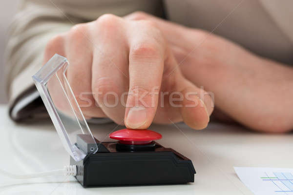 Businessperson Hand Pressing Emergency Button Stock photo © AndreyPopov
