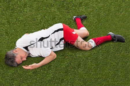 Piłkarz cierpienie kolano szkoda mężczyzna Zdjęcia stock © AndreyPopov