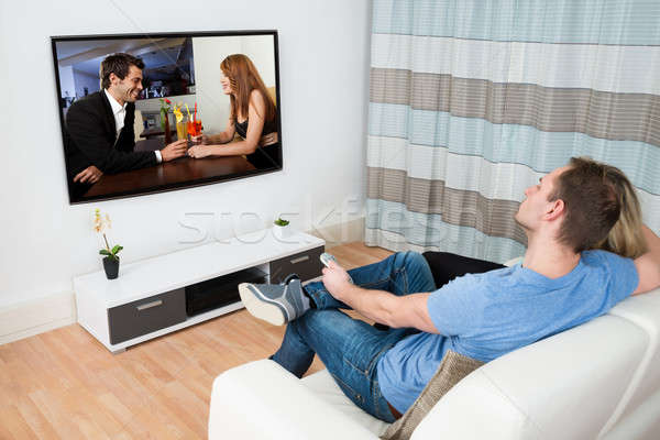 Stock photo: Couple Watching Movie On Television