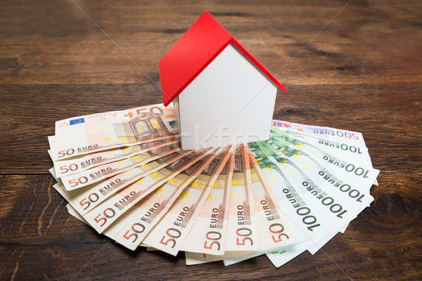 House Model And Banknotes Stock photo © AndreyPopov
