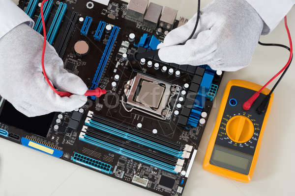Person Hands Checking Motherboard With Multimeter Stock photo © AndreyPopov
