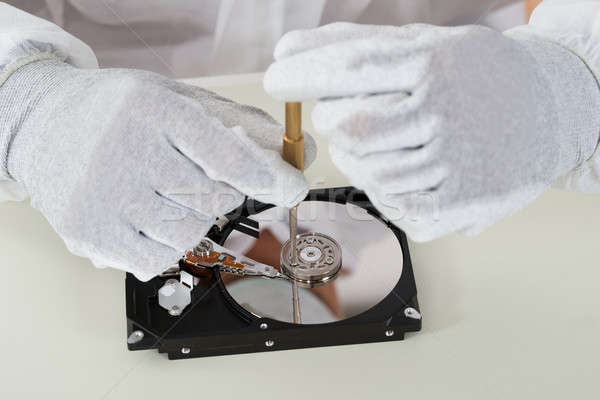 Person Repairing Harddisk Using Screwdriver Stock photo © AndreyPopov