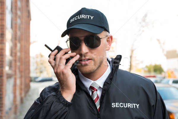 Stock photo: Security Guard Talking On Walkie-talkie