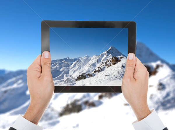 Person Hand Taking Photo Of Snowy Mountain Stock photo © AndreyPopov