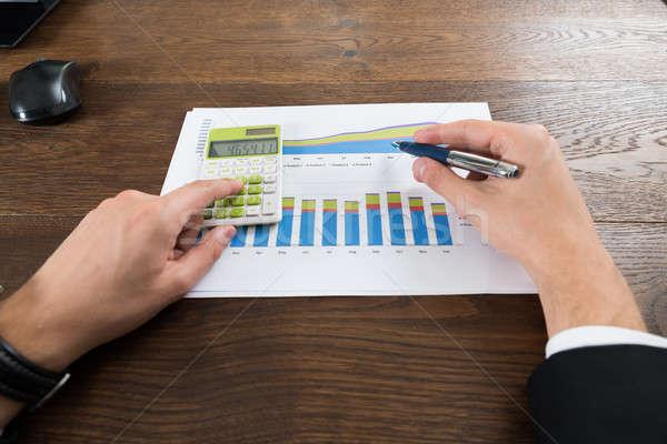 Businessperson Analyzing Statistical Data Stock photo © AndreyPopov
