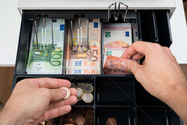 Stock photo: Person Hands With Money Over Cash Register