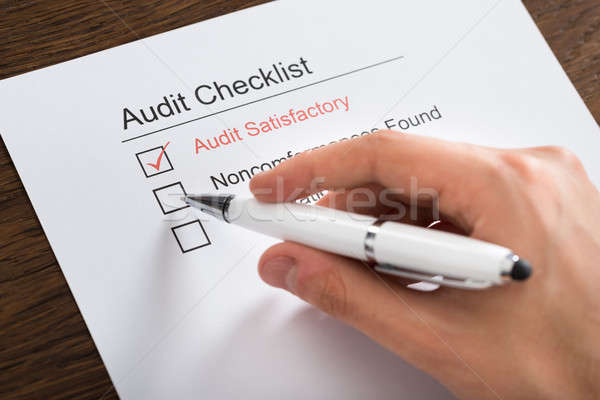Person Filling Audit Checklist Form At Desk Stock photo © AndreyPopov