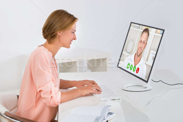 Woman Videochatting On Computer Stock photo © AndreyPopov