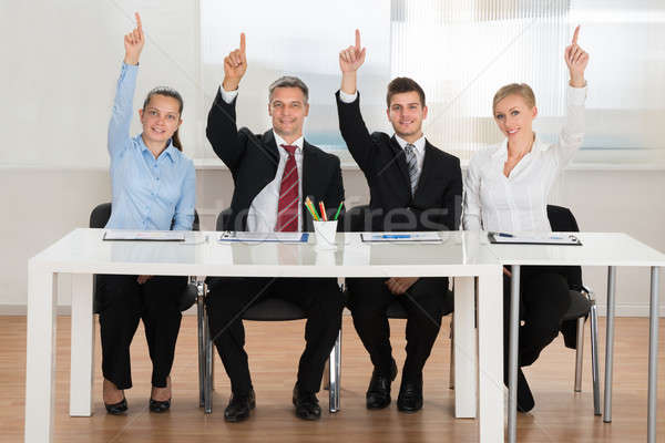 Businesspeople Raising Hands In Conference Stock photo © AndreyPopov