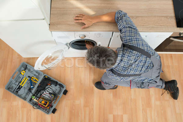 Handyman Checking Washing Machine At Home Stock photo © AndreyPopov