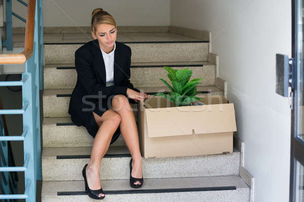 Businesswoman With Belongings Sitting On Steps At Office Stock photo © AndreyPopov