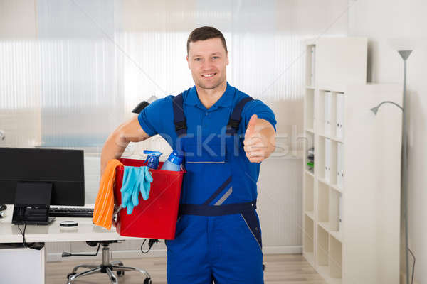 Janitor Showing Thumbs Up While Carrying Bucket Stock photo © AndreyPopov