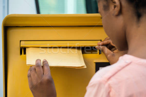 Stock photo: Person's Hand Inserting Letter In Mailbox