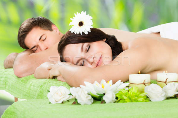 Relaxed Couple Lying At Beauty Spa Stock photo © AndreyPopov