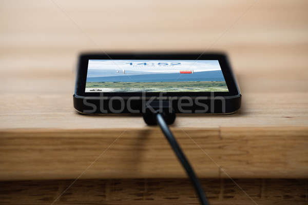 Closeup Of Smart Phone Connected To Charger Stock photo © AndreyPopov