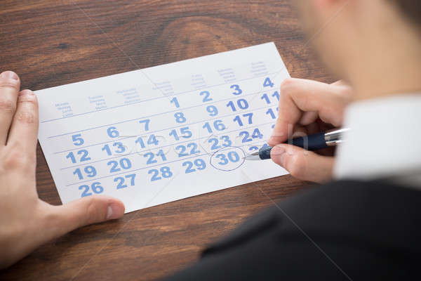 Businessman Marking Date On Calendar Stock photo © AndreyPopov