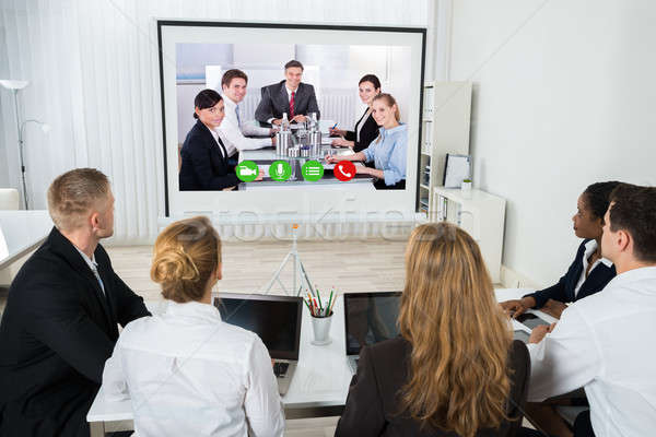 Businesspeople Videoconferencing At Workplace Stock photo © AndreyPopov