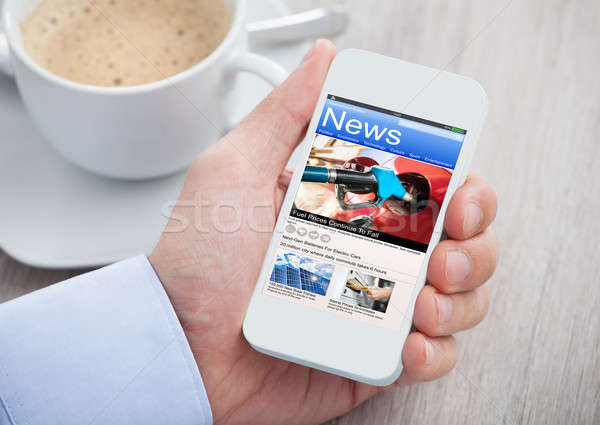 Person Reading News On Phone Stock photo © AndreyPopov