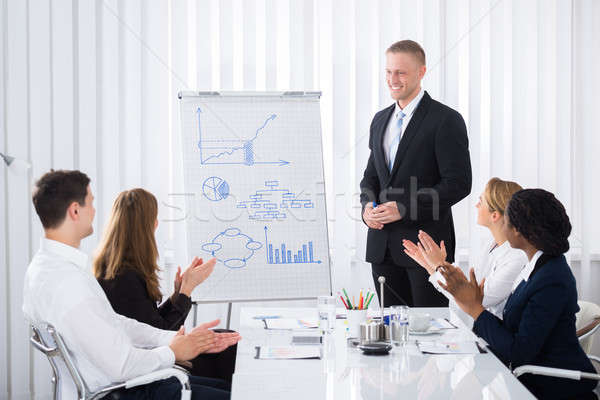 Businesspeople Clapping After Presentation Stock photo © AndreyPopov