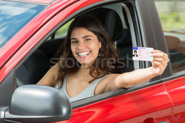 Woman Showing Her Driving License Stock photo © AndreyPopov