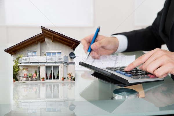 üzletember ház modell számológép irodai asztal iroda Stock fotó © AndreyPopov