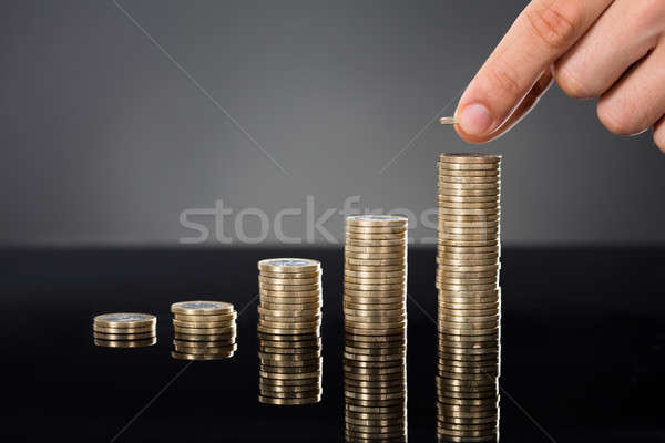 Person Stacking Coins On Desk Stock photo © AndreyPopov