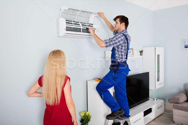 Technician Repairing Air Conditioner At Home Stock photo © AndreyPopov