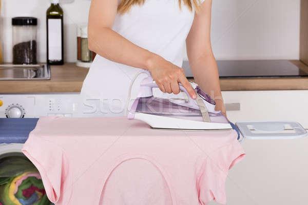 Nő vasalás ruházat elektromos vasaló közelkép Stock fotó © AndreyPopov