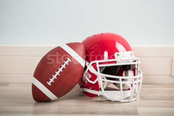 Rugby ball kask drewnianej podłogi piłka nożna tle Zdjęcia stock © AndreyPopov