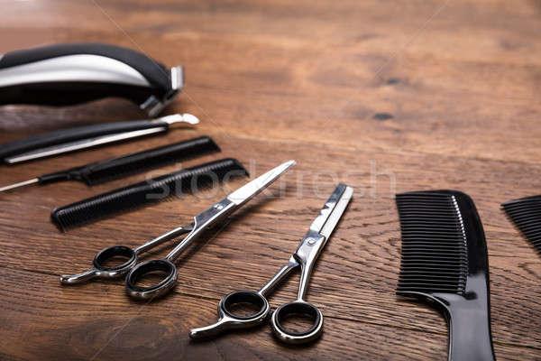 Hairdresser Tools On Wooden Desk Stock photo © AndreyPopov