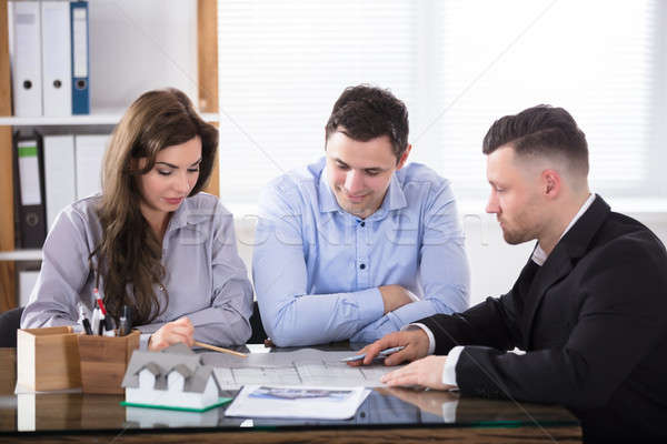 Real Estate Agent Meeting With Couple Stock photo © AndreyPopov
