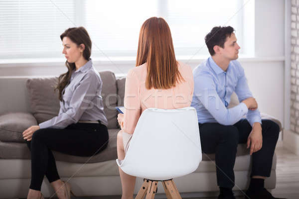 Psychologist With Displeased Couple Stock photo © AndreyPopov