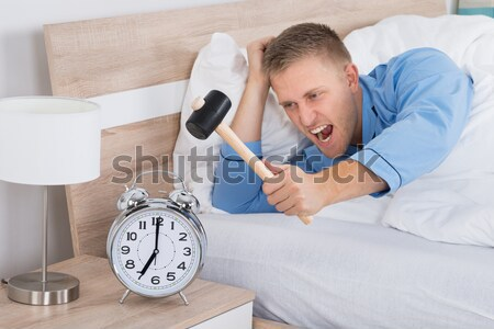 Angry Man Holding Gun And Alarm Clock Stock photo © AndreyPopov