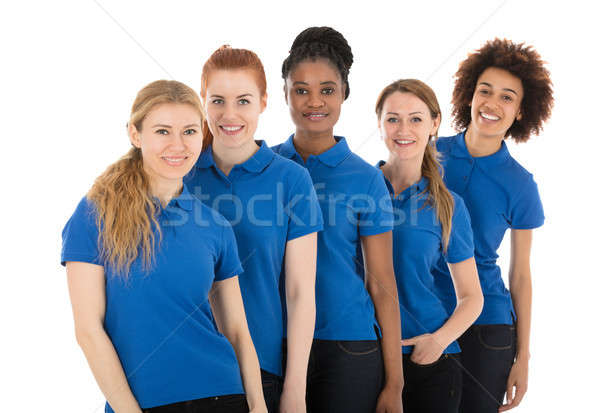 Group Of Young Female Janitors Standing In Row Stock photo © AndreyPopov