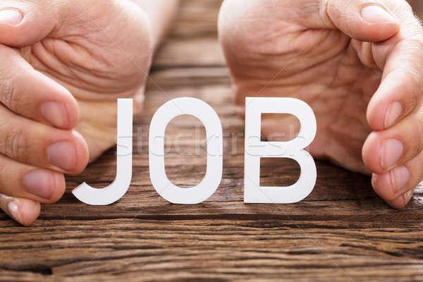Hand Covering Job Text Stock photo © AndreyPopov