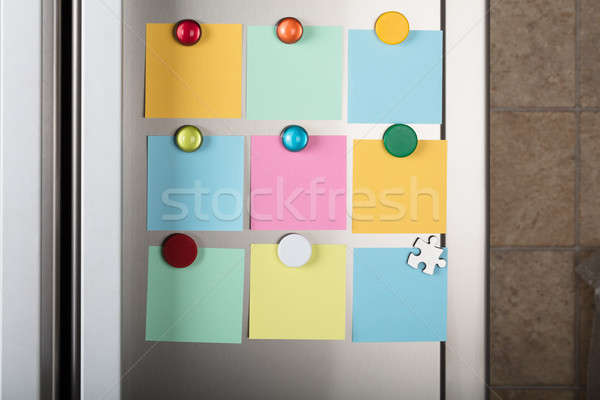 Blank Notes Attached With Colorful Magnetic Thumbtacks Stock photo © AndreyPopov