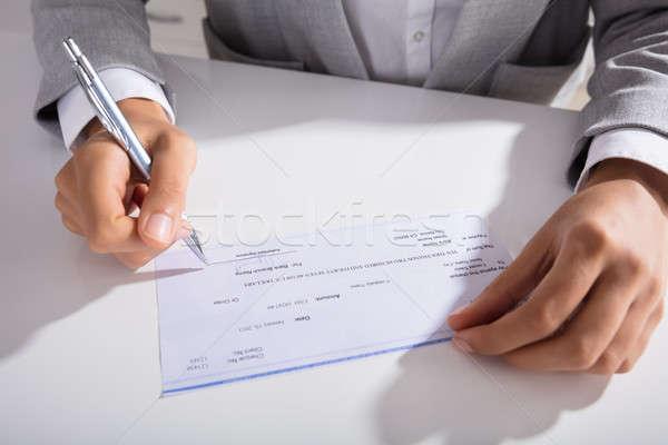 Personne main signature chèque stylo Photo stock © AndreyPopov